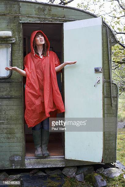 young woman holding hands out  feeling rain