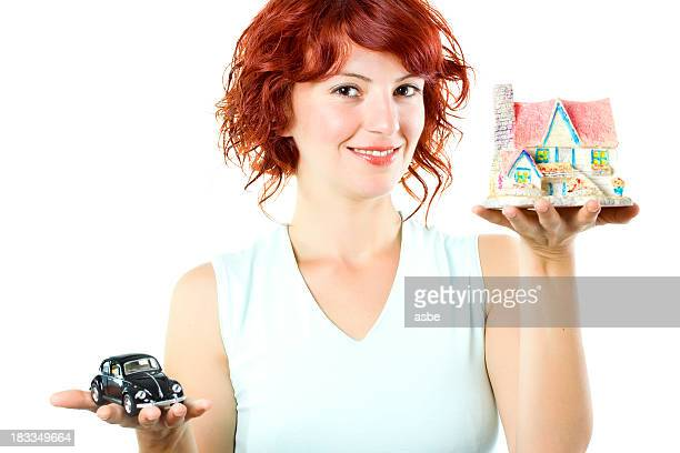 Young Woman Holding House and Car
