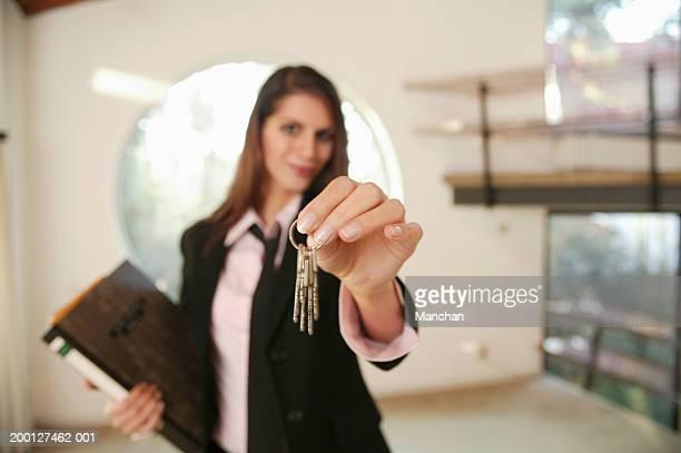Young woman holding keys (focus on keys)