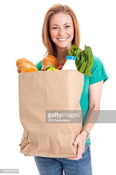 Young Woman Holding Large Bag of Healthly Groceries