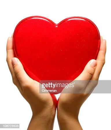 Young Woman Holding Large Plastic Red Heart : Stock Photo