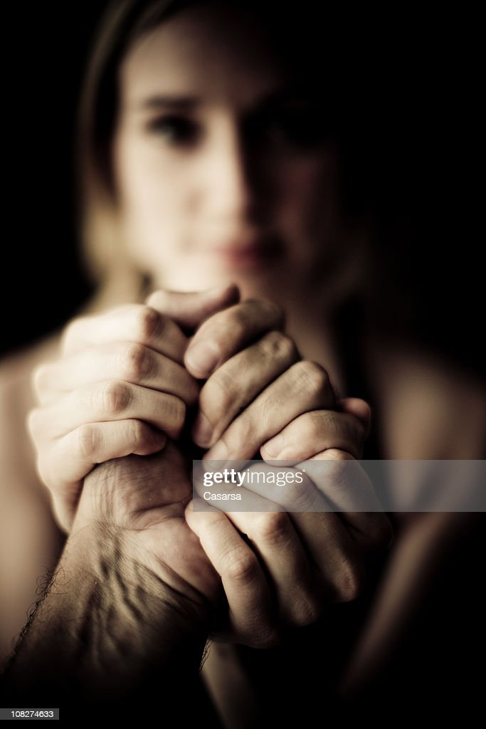 Young Woman Holding Man's Hand, Low Key : Stock Photo