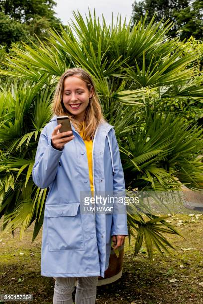 Young woman holding mobile phone.