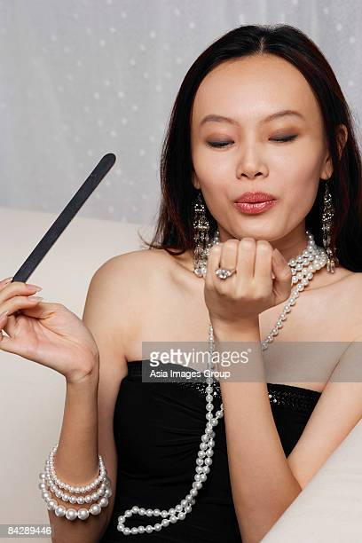 Young woman holding nail file