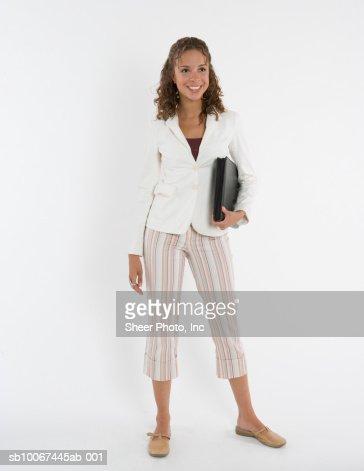 Young woman holding portfolio, studio shot