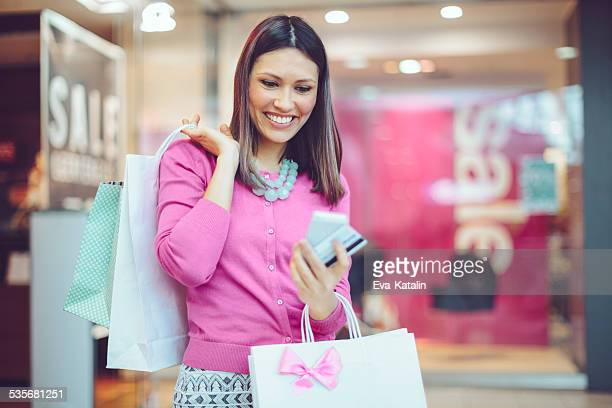 Young woman holding shopping bags in a shopping mall