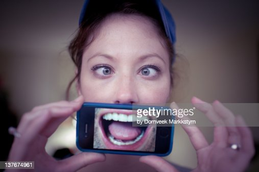 Young woman holding smartphone : Stock Photo