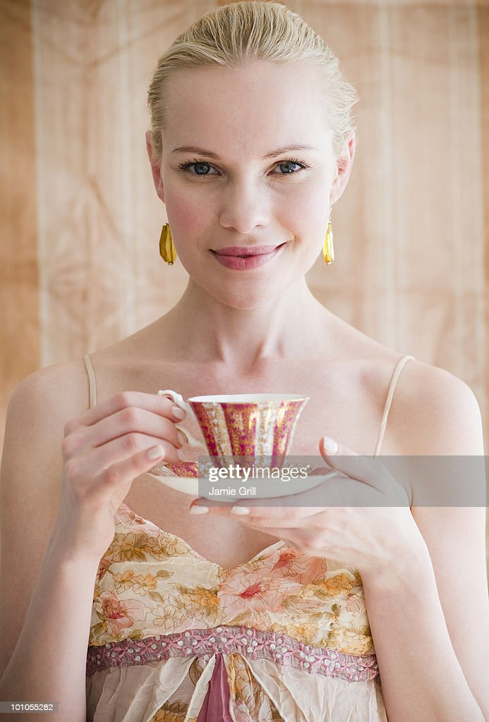 Young woman holding tea cup : Stock Photo