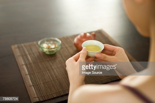 Young woman holding teacup : Stock Photo