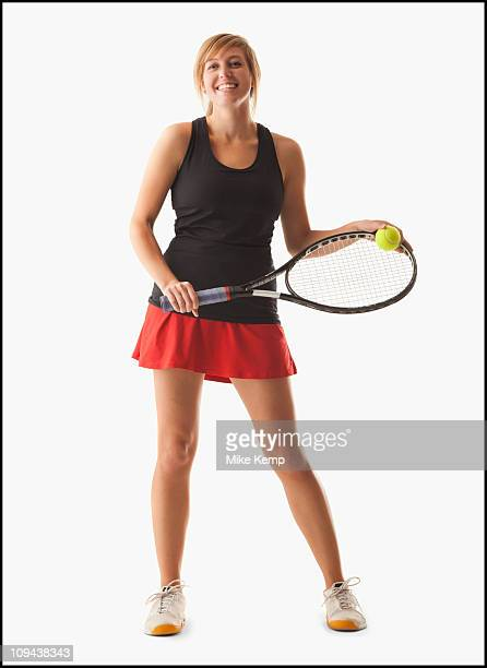 Young woman holding tennis racket