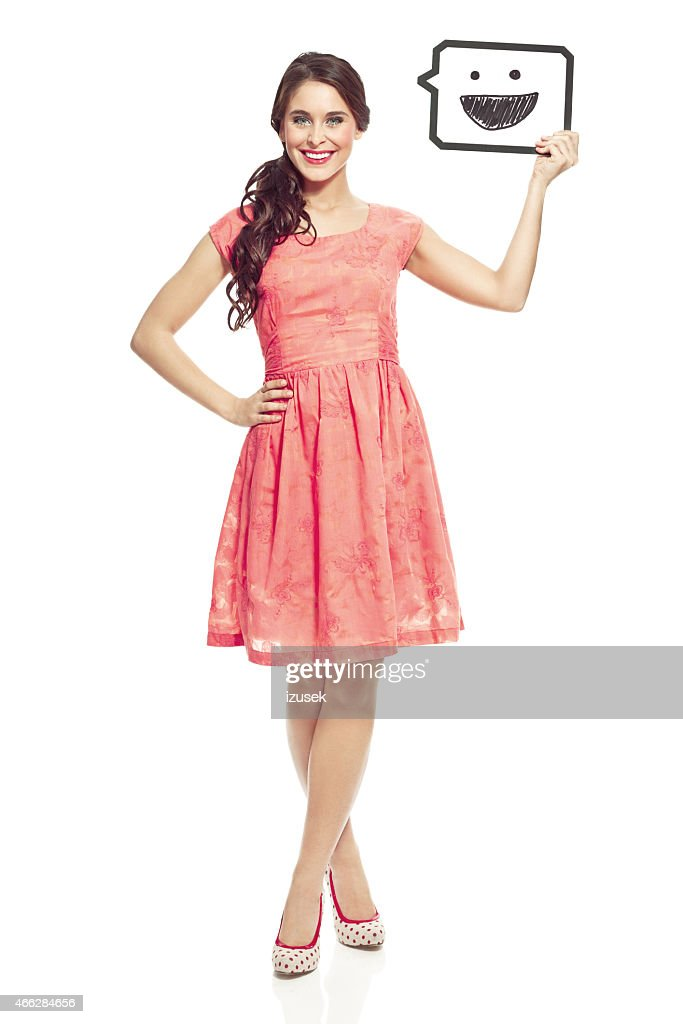 Young woman holding thought bubble
