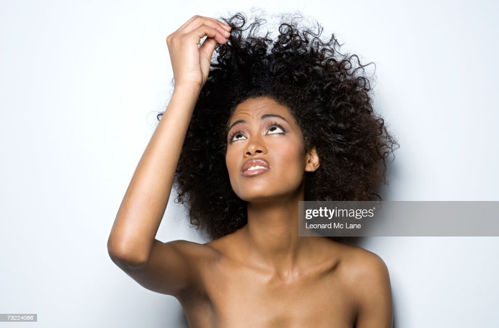 Young woman holding up her hair, close-up : Stock Photo