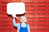 young woman holding up speech bubble