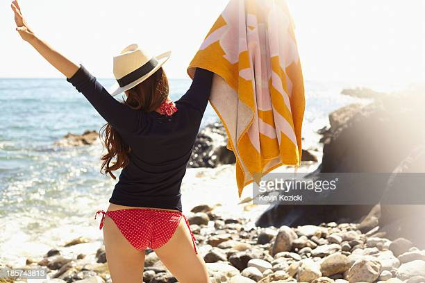 Young woman holding up towel,  Palos Verdes,  California,  USA