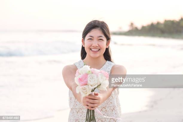 Young Woman Holding White and Pink Rose Bouquet on Beach