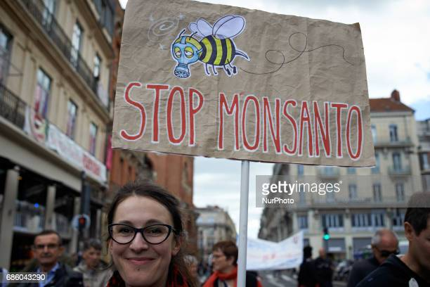 A young woman holds a placard for the International March against Monsanto It took place in Toulouse as elsewhere in Europe or in North America They...