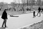 A young woman holds her hands to her head as she stands near the body of student Jeffrey Miller who was shot and killed by guardsmen during an...