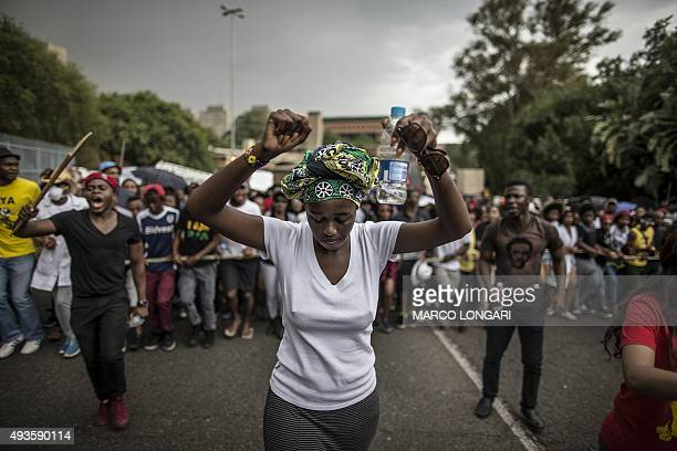 A young woman holds up her fists as students march through the campus of the University of the Witwatersrand in Johannesburg on October 21 during a...
