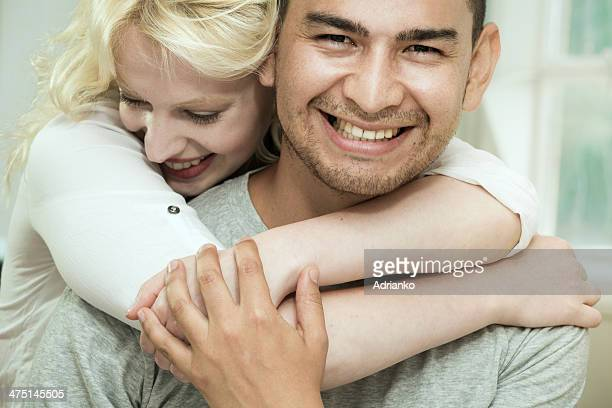 Young woman hugging boyfriend