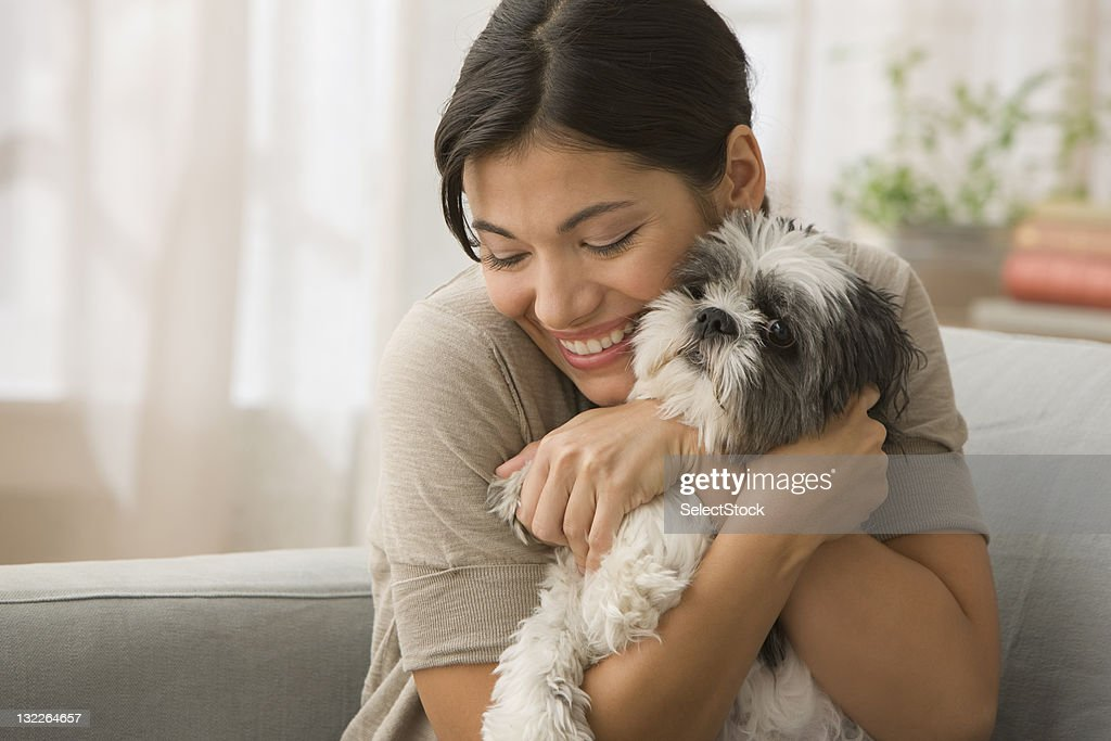 Young Woman hugging dog : Stock Photo