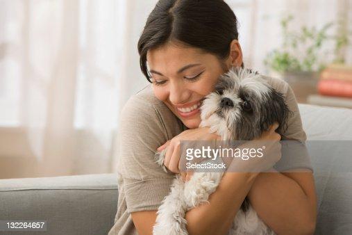 Young Woman hugging dog : Stock Photo