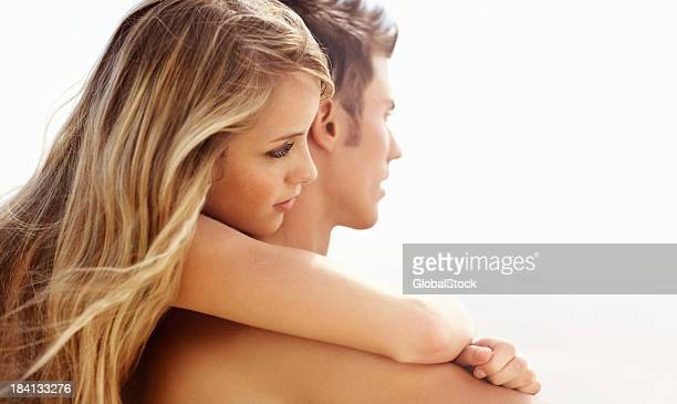 Young woman hugging her boyfriend