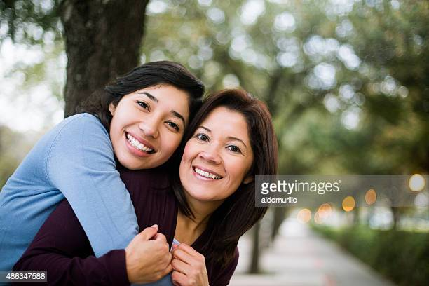 Young woman hugging her mother