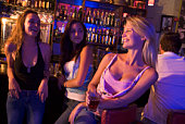 Young woman in a bar with friends