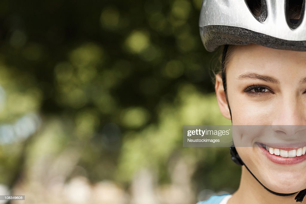 Young Woman in a Bicycle Helmet : Stock Photo