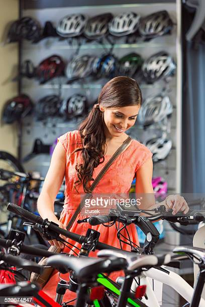 Young woman in a bike store