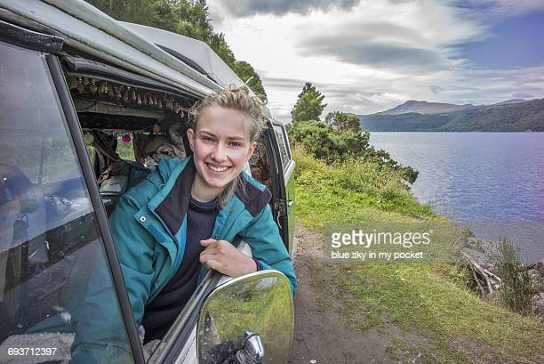 A young woman in a camper van at Loch Ness