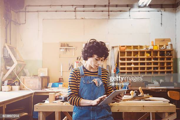 Young woman in a carpentry workshop