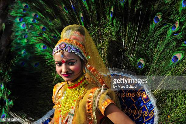 Young woman in a costume of peacock feathers, Jaipur Elephant Festival, Rajasthan, India