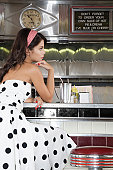 Young Woman in a Diner