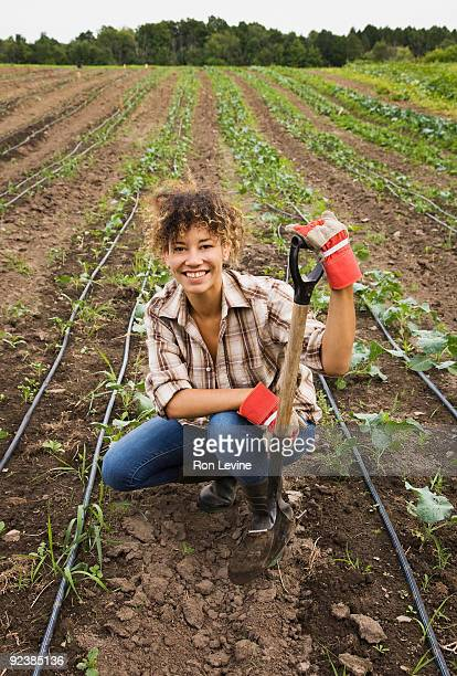 Young woman in a field at an Organic farm