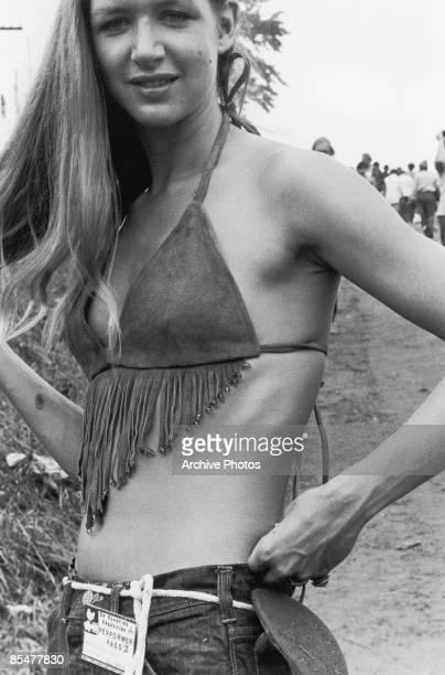 A young woman in a fringed buckskin top at the Woodstock Music Festival Bethel New York 15th17th August 1969