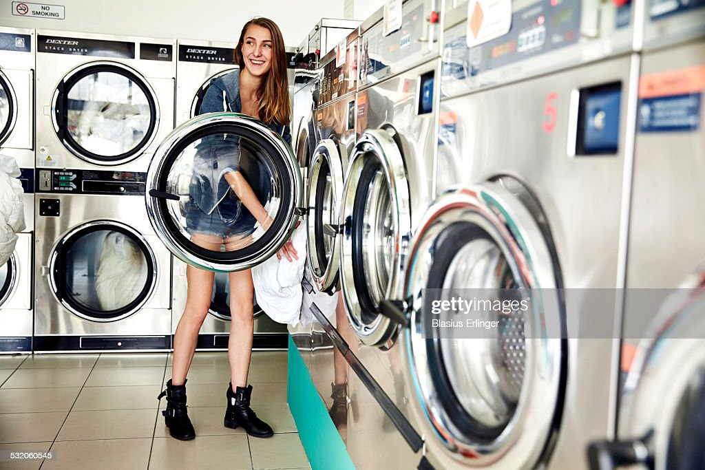 Young Woman in a Laundromat