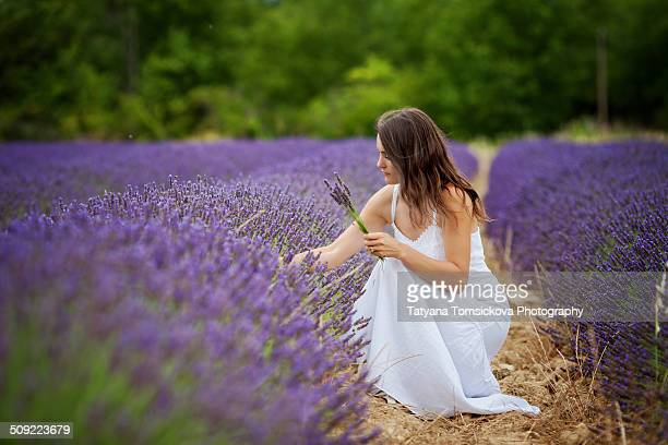 Young woman in a long dress in lavender field