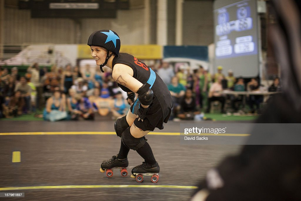 Young woman in a roller derby bout : Stock Photo