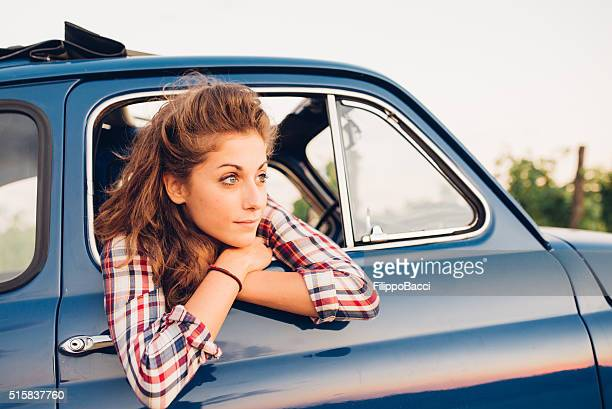 Young Woman In A Vintage Car