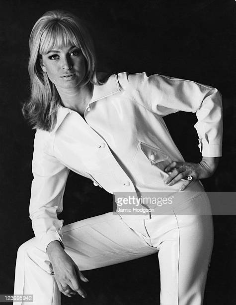 A young woman in a white jacket and trousers circa 1965