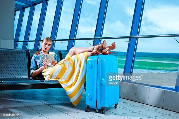 Young woman in an airport lounge