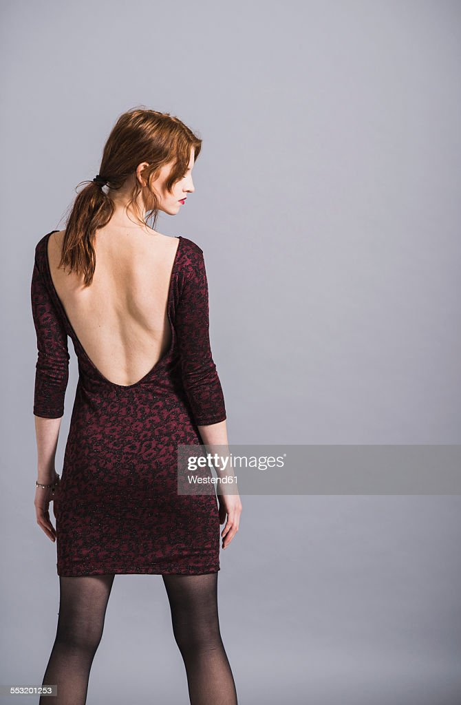 Young woman in backless dress