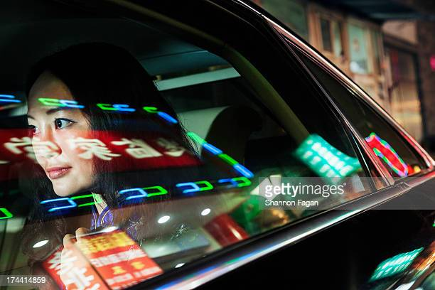 Young Woman In Backseat of Car, Reflected Lights
