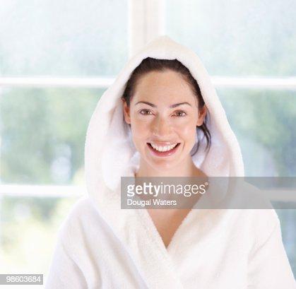 Young woman in bathrobe. : Stock Photo