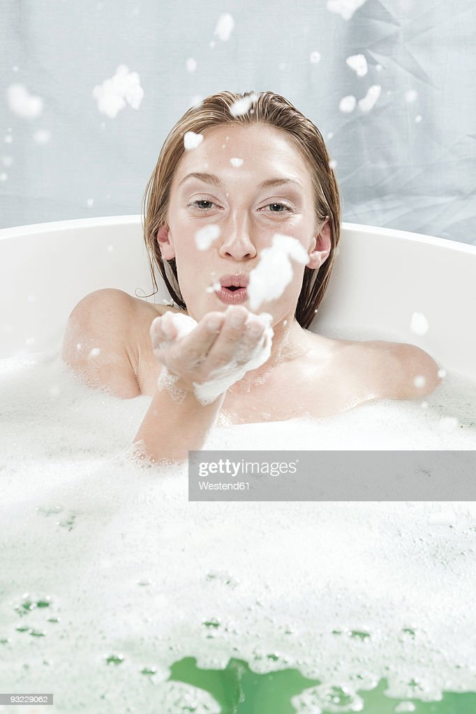 Portrait Of Young Woman Blowing A Kiss And Taking Selfie Against ...