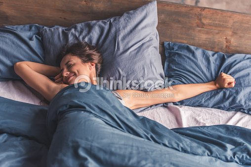 Young woman in bed : Stock Photo