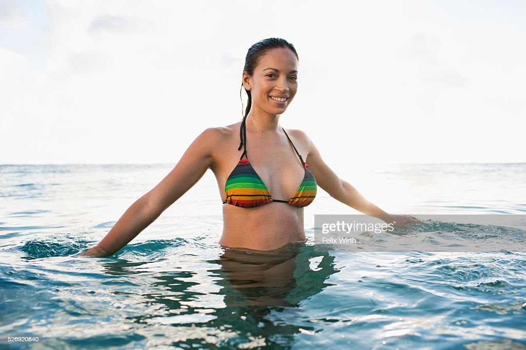 Young woman in bikini bathing in sea : Foto stock