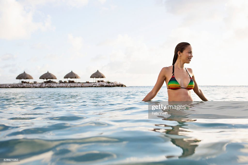 Young woman in bikini bathing in sea : Stock-Foto