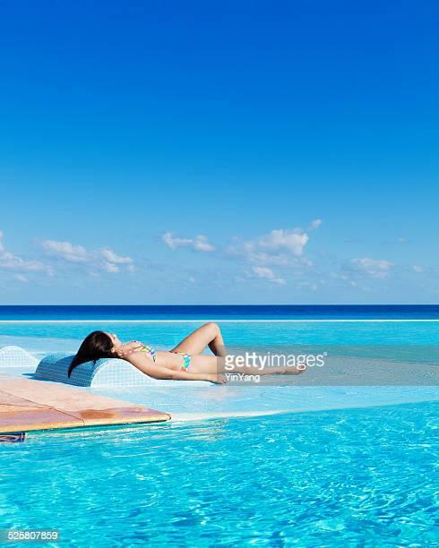 Young Woman in Bikini on Vacation Enjoying Infinity Pool Vt